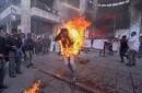 El campesino Agustín Gómez Pérez, de 21 años, corre en llamas después de que permitiera que le rociaran gasolina y le prendieran fuego durante una protesta en Tuxtla Gutiérrez, capital del estado de Chiapas, México.